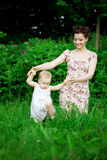 Baby and mother in  park Royalty Free Stock Photography