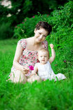 Baby and mother in  park Stock Photos
