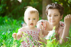 Baby with  mother in  park Stock Image