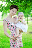 Baby and mother in  park Royalty Free Stock Photos