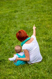 Baby with mother at the park Stock Photo