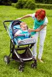 Baby with mother at the park Stock Photos
