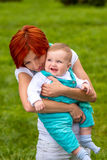 Baby with mother at the park Royalty Free Stock Photo