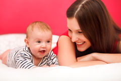 Baby and Mother playing. Happy Smiling Family Portrait royalty free stock image