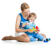 Baby and mother playing together with puzzle toy Stock Photo