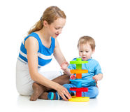 Baby and mother playing together with puzzle toy Royalty Free Stock Photos