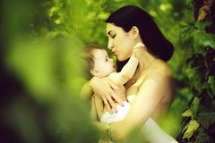 Baby and mother playing topless stock image