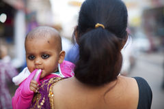 Baby in mother's arms in India Royalty Free Stock Photos