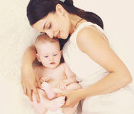 Baby in the mother's embrace stock photo