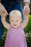 Baby with Mother's Hands. Close-up of toddler holding on to mother's hands above her Royalty Free Stock Photos