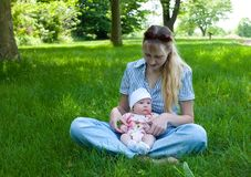 Baby in Mother\'s Lap Outdoors Royalty Free Stock Photo