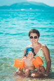 Baby and mother. In a sea royalty free stock image