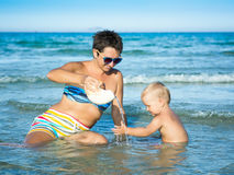 Baby and mother. In a sea stock images