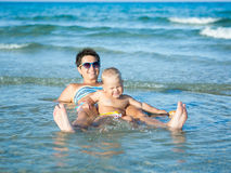 Baby and mother. In a sea royalty free stock photos