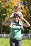 Baby on mother shoulders Royalty Free Stock Images