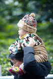 Baby on mother shoulders Royalty Free Stock Photo