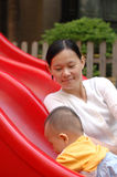 Baby and mother on the slide Royalty Free Stock Images