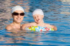 Baby with mother are swimming in pool Royalty Free Stock Photography