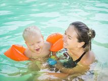 Baby and mother. In swimming pool royalty free stock image