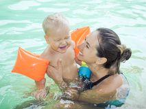 Baby and mother. In swimming pool royalty free stock photo