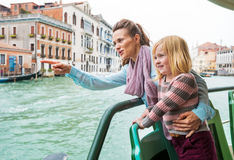 Baby and mother  travel by vaporetto in venice Stock Image