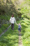 Baby and mother walking in nature Stock Image