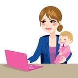 baby mother working Στοκ Εικόνες
