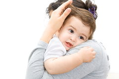 Baby in mothers arms Stock Photos