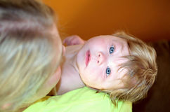 Baby in mothers arms Royalty Free Stock Photo