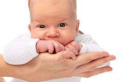 Baby on mothers hands. Royalty Free Stock Images
