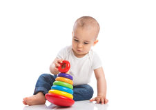 Baby with moto skills toys Stock Images