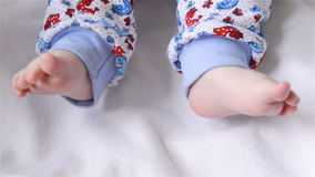 Baby moves legs stock footage