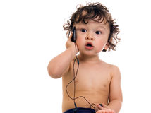 Baby with MP3 player. Baby with MP3 player,isolated on a white background Stock Photo