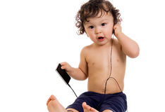 Baby with MP3 player. Stock Photo