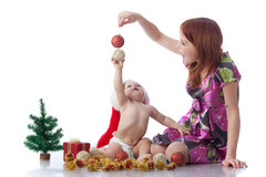 Baby and mum with Christmas  decoration Stock Photo