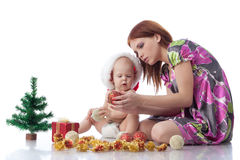 Baby and mum with Christmas  decoration Royalty Free Stock Photo
