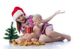 Baby and mum with Christmas  decoration Royalty Free Stock Images