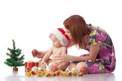 Baby and mum with Christmas  decoration Royalty Free Stock Image