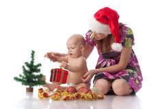 Baby and mum with Christmas  decoration Royalty Free Stock Photos