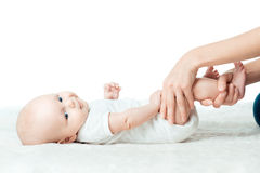 Baby with mum is making massage Stock Images