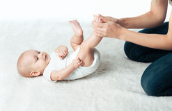 Baby with mum is making massage Royalty Free Stock Images