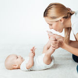 Baby with mum is making massage Royalty Free Stock Image