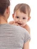 Baby on mum's hands. Stock Image