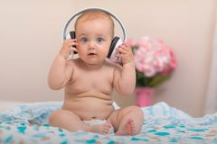 Baby and music stock image