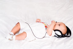 Baby Music Listening Stock Image