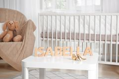Baby name ISABELLA composed of wooden letters on table. Choosing name concept Royalty Free Stock Images