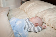 Baby Napping in Bed Stock Photo