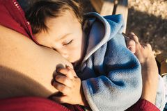 Free Baby Naps While Being Breastfed By His Mother Outdoors Stock Photography - 168420842