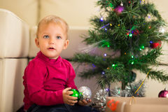 Baby near Christmas tree Stock Image