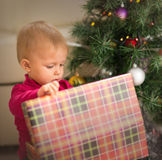 Baby near Christmas tree Royalty Free Stock Images